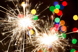 Two sparklers and background with colorful bokeh