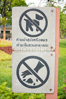 Signs warn pet And do not litter