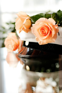student's cap and roses on reflective surface