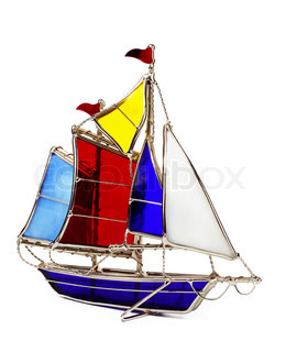 Model sailboat made of glass, isolated