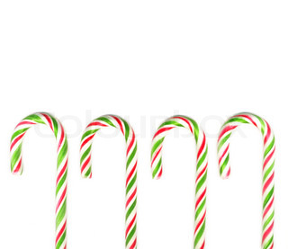 Four red and green Christmas candy canes isolated on white real photo