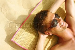 Man Sunbathing on the beach