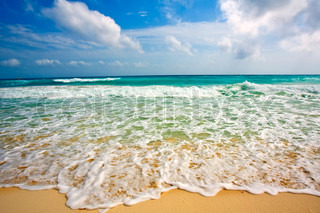 Waves on beautiful golden beach