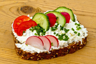 a bread with cottage cheese and cheese spread with vegetables and healthy eating