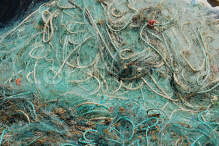 Old fishing nets in the port of Cascais, Portugal