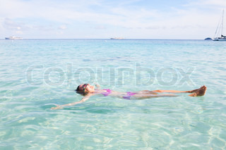 Girl Floating In Andaman Sea