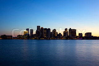 Sunset view of Boston skyline seen from Piers Park, USA