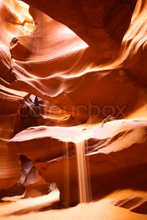 Falling sand in Upper Antelope Canyon, Arizona, USA