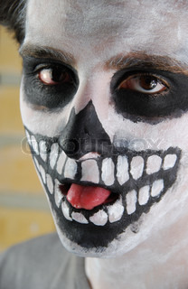 Portrait of a creepy skeleton guy Carnival face painting