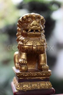 Lion statue at buddhistic temple in Shanghai, China