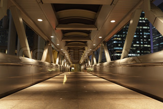 Pedestrian Bridge in the city of Hong Kong at night