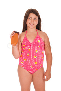 little girl in the pink bathing suit in the flower stock photo