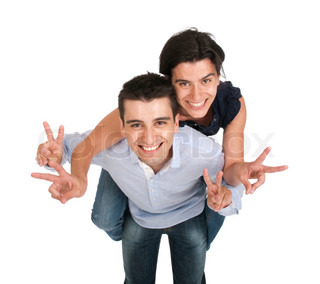Brother and sister showing victory sign