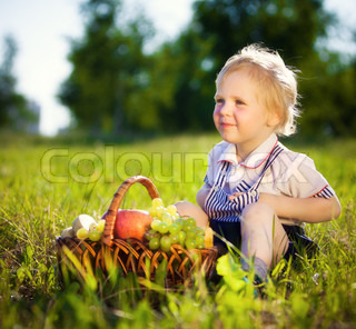 little boy with a basket of fruit