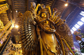 Thousand arms god statue in Longhua temple, Shanghai China