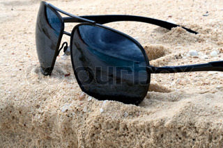 Sunglasses on a sand