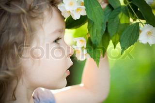 Child with jasmin flower