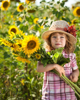 Child with bunch of sunflowers