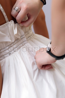 Bride getting ready for the wedding ceremony.