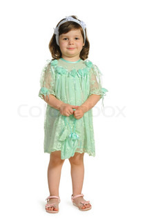 The lovely little girl in a green dress