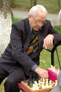 A man playing chess in the park