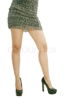 Beautiful legs of young woman on isolated white background
