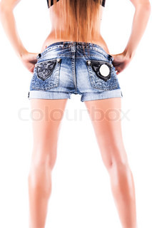Smooth female legs on a bright white background