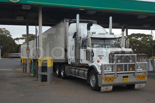 Road train at gas station