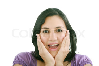 Portrait of young surprised girl holding her face