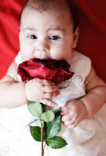Cute girl with red rose