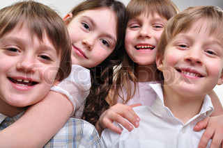 happy group of children hugging together