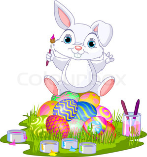 Easter Bunny sitting on eggs