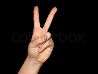 Peace and victory sign isolated on black
