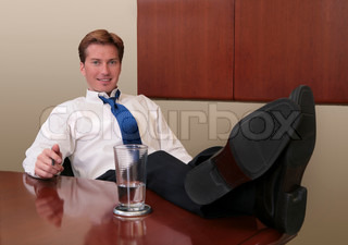 businessman with his feet up on the table