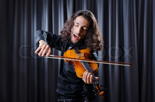 Young violin player playing