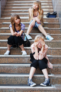 Teenage girls relaxing on a steps
