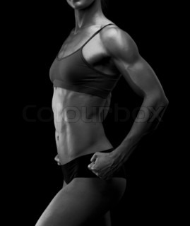 Black and white image of a muscular female body against black background