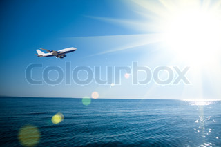 Airplane flying over the sea
