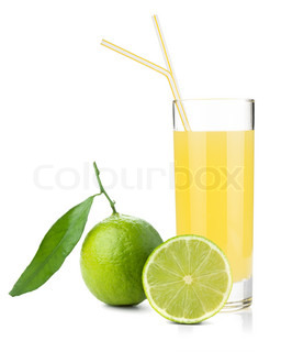 Lime juice glass with ripe limes