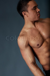 Sexy naked torso, hand and head of fit and neat young man in studio. Fit and neat collection.