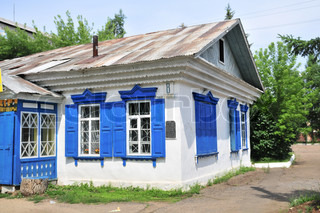 Russian rural house with carved windows