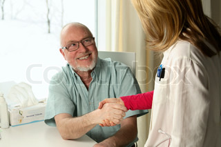 trustful handshake between practitioner and patient, shallow DOF