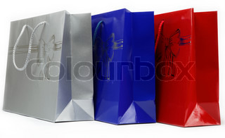 Red, blue and gray gift bags on a white background