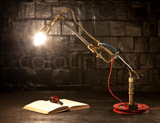 Light from a gas burner at the table next to the black for Gas pipe desk lamp