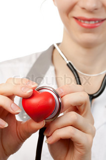 Woman doctor with stethoscope and heart