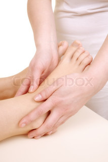 Massage the feet of a young woman