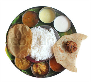 South indian plate lunch on banana leaf on white