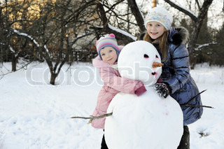 Sisters with snowman