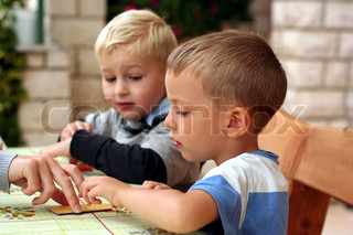 Children play board game