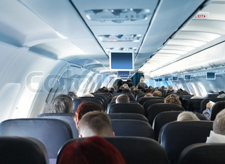 Overhead view of passengers traveling in airplane cabin interior economy class